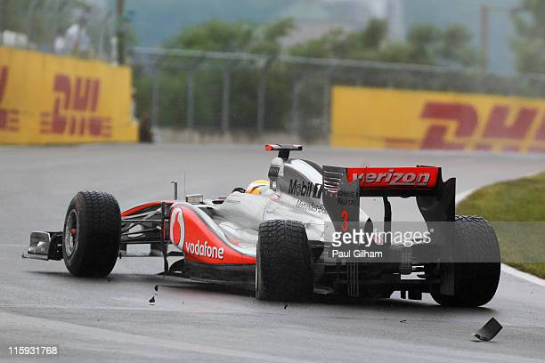 Lewis Hamilton of Great Britain and McLaren suffers damage to his rear left wheel after driving too close to team mate Jenson Button of Great Britain...