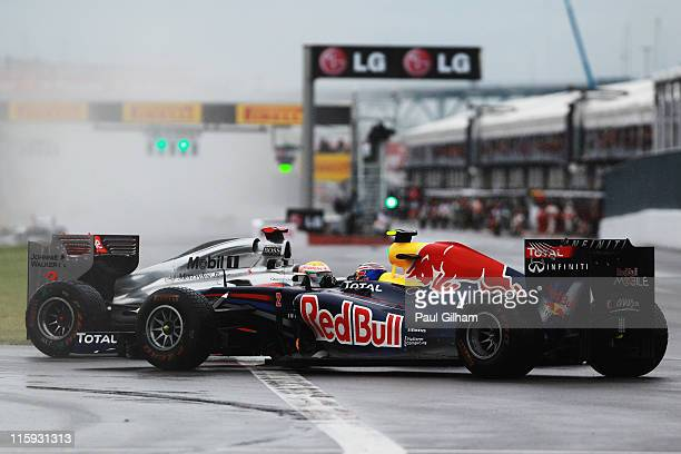 Lewis Hamilton of Great Britain and McLaren watches as Mark Webber of Australia and Red Bull Racing spins in front of him during the Canadian Formula...
