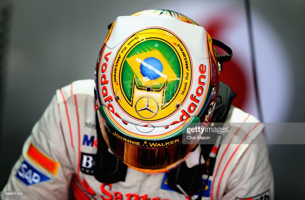 Lewis Hamilton of Great Britain and McLaren wears a specially designed helmet giving thanks to his team as he prepares to drive during practice for the Brazilian Formula One Grand Prix at the Autodromo Jose Carlos Pace on November 23, 2012 in Sao Paulo, Brazil.