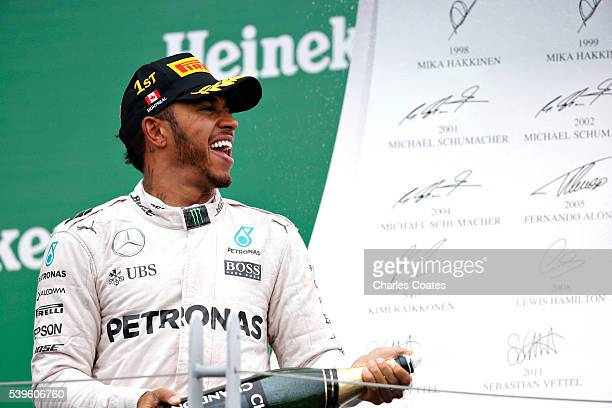 Lewis Hamilton of Great Britain and Merccedes GP celebrates his win on the podium during the Canadian Formula One Grand Prix at Circuit Gilles...