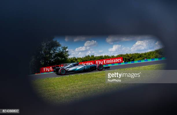 Lewis Hamilton of Great Britain and Mercedes AMG Petronas driver goes during the free practice session at Pirelli Hungarian Formula 1 Grand Prix on...
