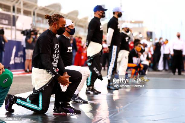 Lewis Hamilton of Great Britain and Mercedes AMG Petronas F1 takes a knee on the grid before the F1 Grand Prix of Bahrain at Bahrain International...