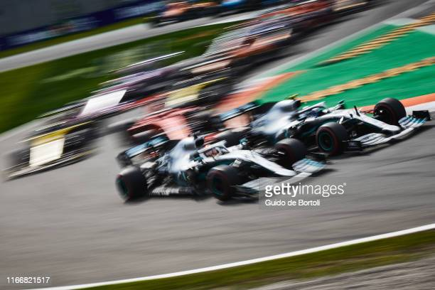 Lewis Hamilton of Great Britain and Mercedes AMG Petronas F1 Team and Valtteri Bottas of Finland and Mercedes AMG Petronas F1 Team battling during...