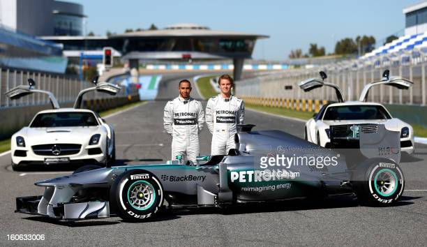 Lewis Hamilton of Great Britain and Mercedes and Nico Rosberg of Germany and Mercedes pose during the Mercedes GP F1 W04 Launch at Circuito de Jerez...