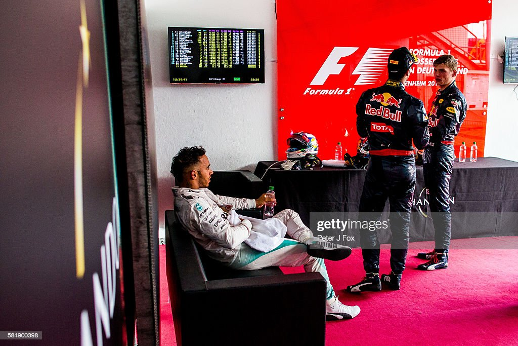 Lewis Hamilton of Great Britain and Mercedes contemplates his win before going to the podium with Daniel Ricciardo of Australia and Max Verstappen of The Netherlands both of Red Bull Racing during the Formula One Grand Prix of Germany at Hockenheimring on July 31, 2016 in Hockenheim, Germany.