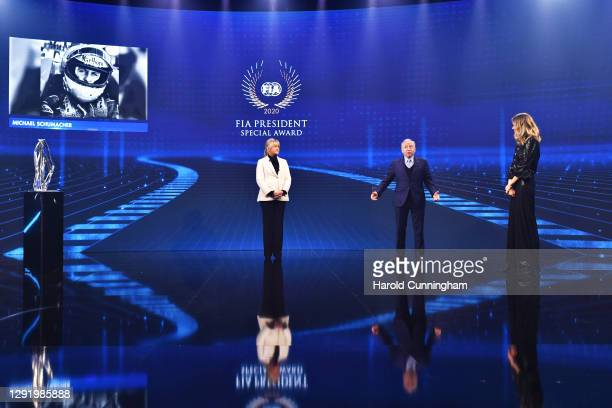Lewis Hamilton of Great Britain and Mercedes GP and Corinna Schumacher, collecting on behalf of Michael Schumacher of Germany are presented with the...