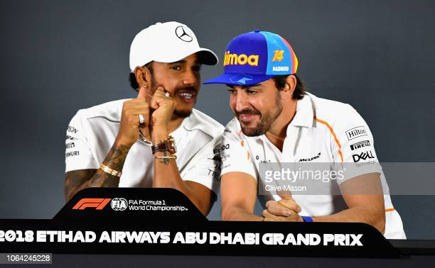 Lewis Hamilton of Great Britain and Mercedes GP and Fernando Alonso of Spain and McLaren F1 talk in the Drivers Press Conference during previews...