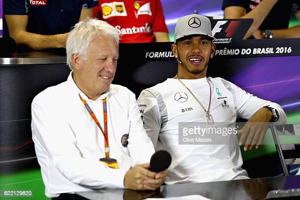 Lewis Hamilton of Great Britain and Mercedes GP and FIA Race Director Charlie Whiting in the Drivers Press Conference during previews for the Formula...