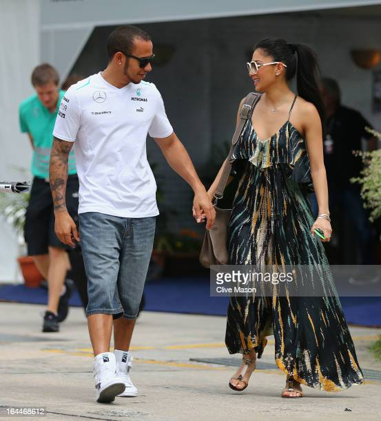 Lewis Hamilton of Great Britain and Mercedes GP and his girlfriend Nicole Scherzinger of the Pussycat Dolls arrive in the paddock before the...