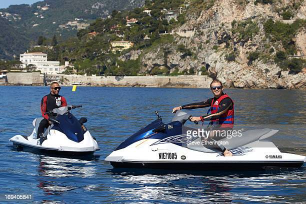 Lewis Hamilton of Great Britain and Mercedes GP and Nico Rosberg of Germany and Mercedes GP jetski during previews to the Monaco Formula One Grand...