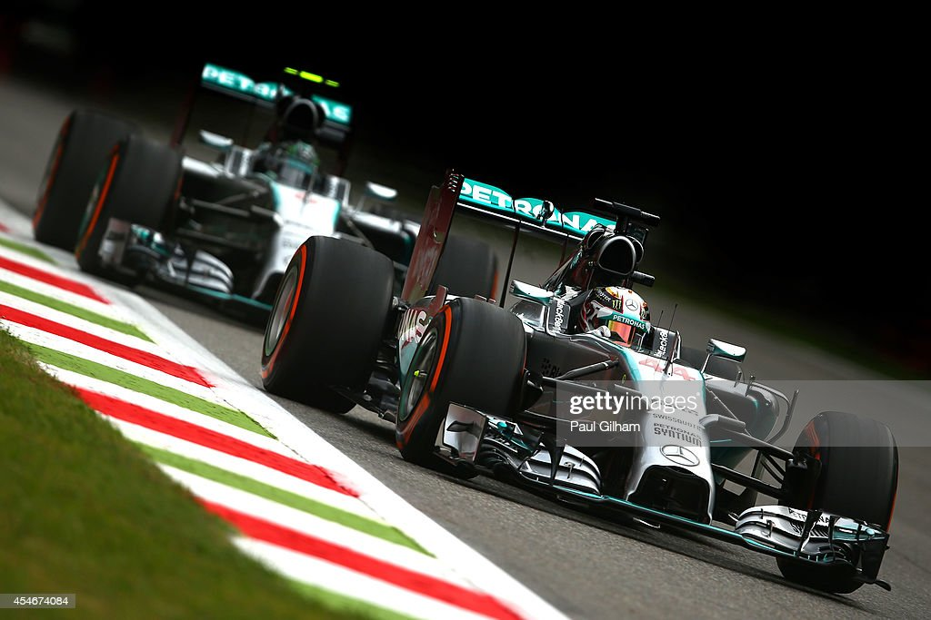 Lewis Hamilton of Great Britain and Mercedes GP and Nico Rosberg of Germany and Mercedes GP drive during Practice ahead of the F1 Grand Prix of Italy at Autodromo di Monza on September 5, 2014 in Monza, Italy.