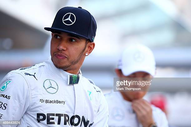 Lewis Hamilton of Great Britain and Mercedes GP and Nico Rosberg of Germany and Mercedes GP attend a team photograph before the Abu Dhabi Formula One...