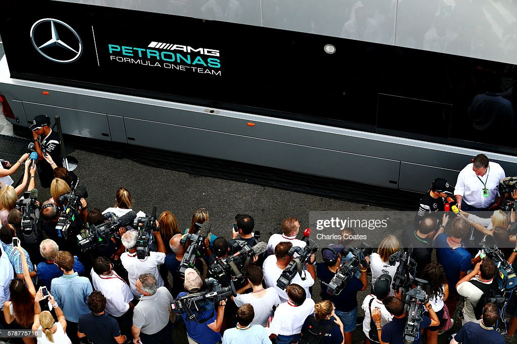 Lewis Hamilton of Great Britain and Mercedes GP and Nico Rosberg of Germany and Mercedes GP talk to the media after practice for the Formula One Grand Prix of Hungary at Hungaroring on July 22, 2016 in Budapest, Hungary.