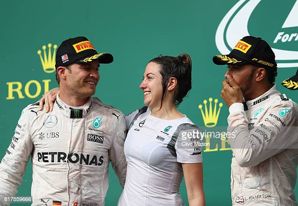 Lewis Hamilton of Great Britain and Mercedes GP and Nico Rosberg of Germany and Mercedes GP celebrate on the podium during the United States Formula...