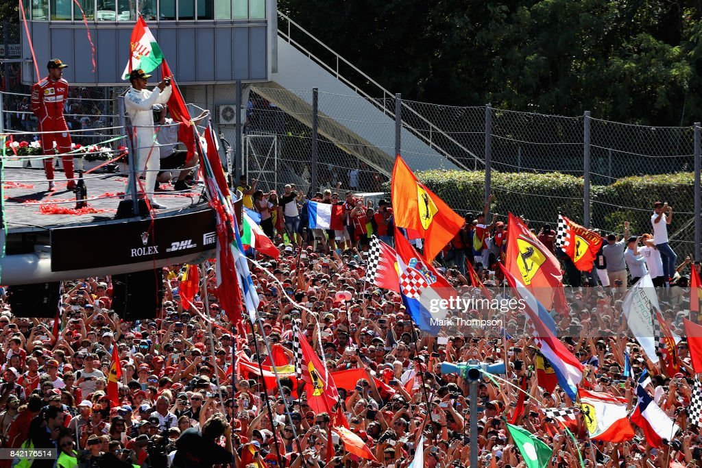 Lewis Hamilton of Great Britain and Mercedes GP and Sebastian Vettel of Germany and Ferrari celebrate on the podium during the Formula One Grand Prix of Italy at Autodromo di Monza on September 3, 2017 in Monza, Italy.