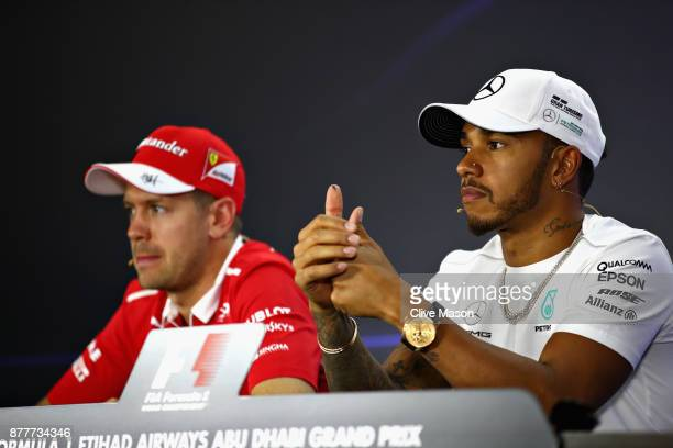 Lewis Hamilton of Great Britain and Mercedes GP and Sebastian Vettel of Germany and Ferrari in the Drivers Press Conference during previews for the...