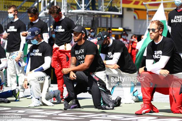 Lewis Hamilton of Great Britain and Mercedes GP and some of the F1 drivers take a knee on the grid in support of the Black Lives Matter movement...