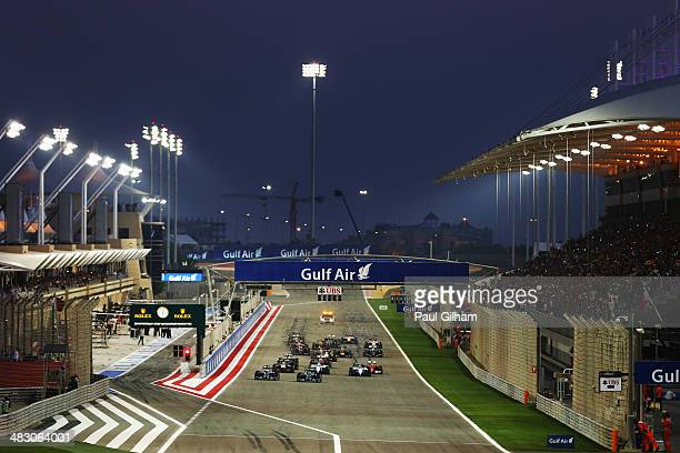 Lewis Hamilton of Great Britain and Mercedes GP and team mate Nico Rosberg of Germany and Mercedes GP lead the field towards the first corner at the...