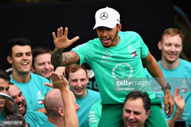 Lewis Hamilton of Great Britain and Mercedes GP and the Mercedes GP team celebrate after their team won the F1 Constructors Championship after the...