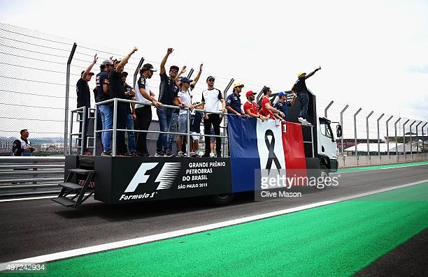 Lewis Hamilton of Great Britain and Mercedes GP and the other drivers are seen during drivers' parade with the french flag to honor the victims of...