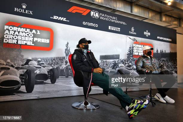 Lewis Hamilton of Great Britain and Mercedes GP and Valtteri Bottas of Finland and Mercedes GP tallk in the Drivers Press Conference during previews...