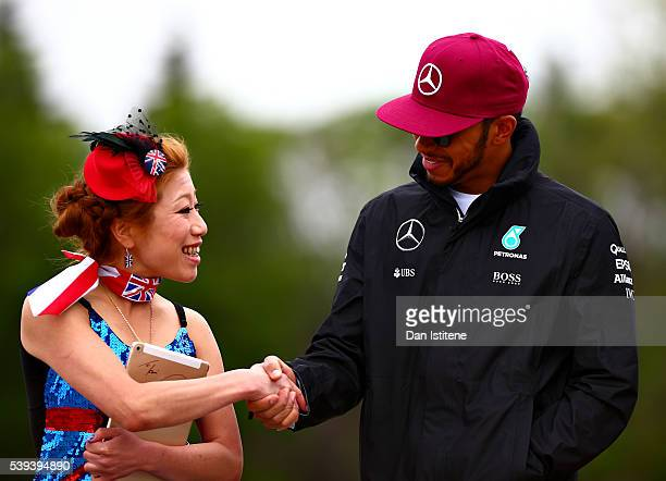 Lewis Hamilton of Great Britain and Mercedes GP arrives at the circuit and greets a fan ahead of final practice ahead of the Canadian Formula One...