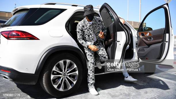 Lewis Hamilton of Great Britain and Mercedes GP arrives at the circuit before practice ahead of the F1 Grand Prix of Abu Dhabi at Yas Marina Circuit...