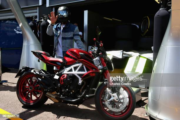Lewis Hamilton of Great Britain and Mercedes GP arrives at the circuit on a motorbike during previews ahead of the Monaco Formula One Grand Prix at...