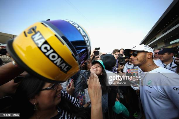 Lewis Hamilton of Great Britain and Mercedes GP at the drivers autograph signing session in the Pitlane during previews to the Formula One Grand Prix...