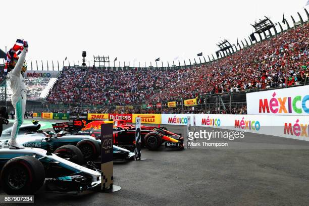 Lewis Hamilton of Great Britain and Mercedes GP celebrates after winning his fourth F1 World Drivers Championship during the Formula One Grand Prix...