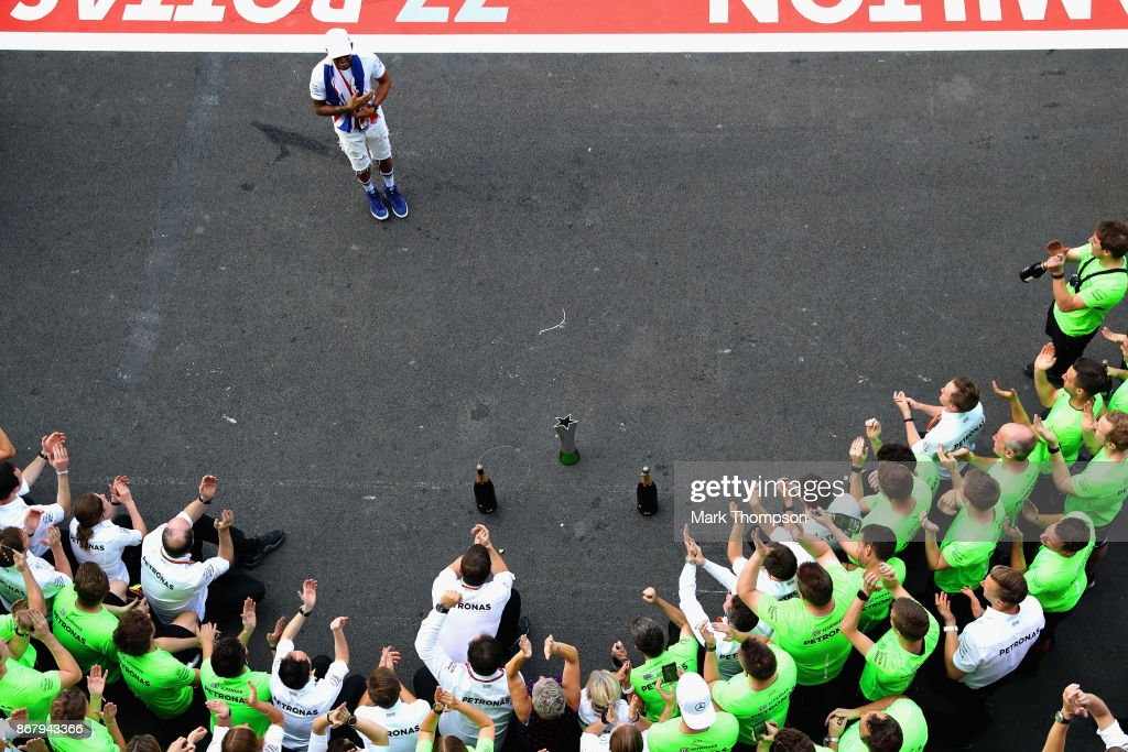 Lewis Hamilton of Great Britain and Mercedes GP celebrates after winning his fourth F1 World Drivers Championship after the Formula One Grand Prix of Mexico at Autodromo Hermanos Rodriguez on October 29, 2017 in Mexico City, Mexico.