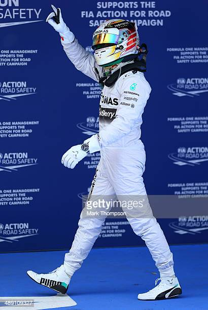 Lewis Hamilton of Great Britain and Mercedes GP celebrates after securing Pole Position during qualifying ahead of the Spanish F1 Grand Prix at...