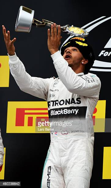 Lewis Hamilton of Great Britain and Mercedes GP celebrates after winning the Formula One Grand Prix of Russia at Sochi Autodrom on October 11, 2015...