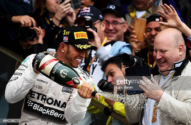 Lewis Hamilton of Great Britain and Mercedes GP celebrates after winning the United States Formula One Grand Prix and the championship at Circuit of...