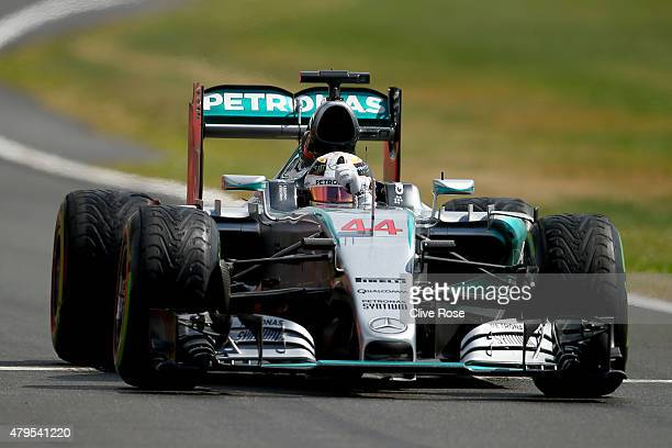 Lewis Hamilton of Great Britain and Mercedes GP celebrates as he approaches Parc Ferme after winning the Formula One Grand Prix of Great Britain at...