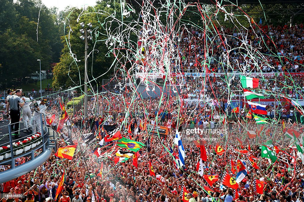 Lewis Hamilton of Great Britain and Mercedes GP celebrates following his victory during the F1 Grand Prix of Italy at Autodromo di Monza on September 7, 2014 in Monza, Italy.