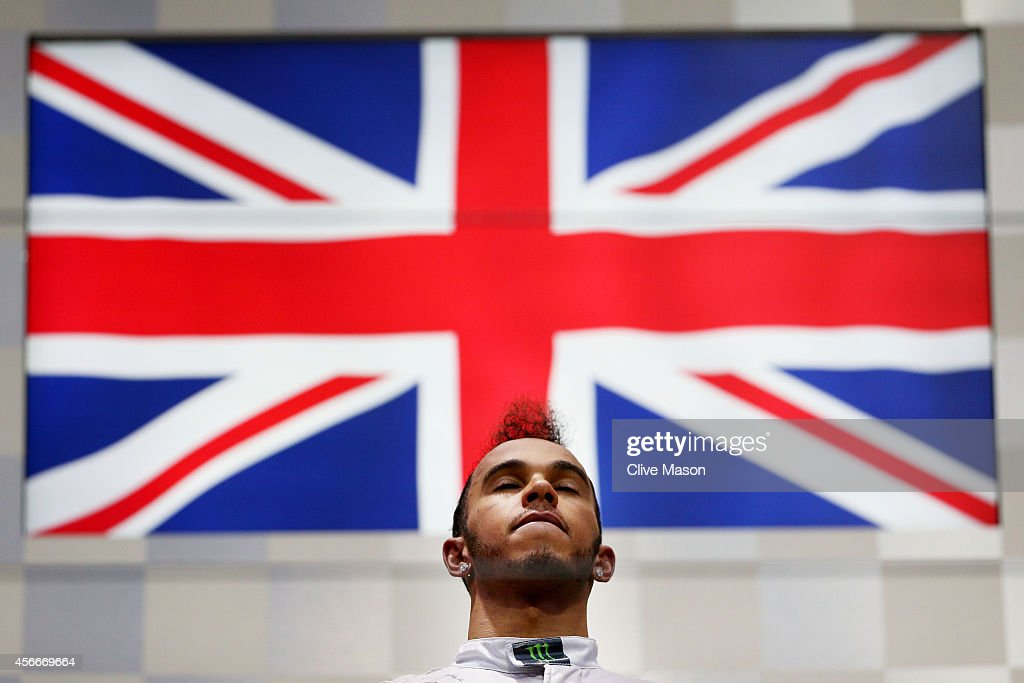 Lewis Hamilton of Great Britain and Mercedes GP celebrates following his victory during the Japanese Formula One Grand Prix at Suzuka Circuit on October 5, 2014 in Suzuka, Japan.