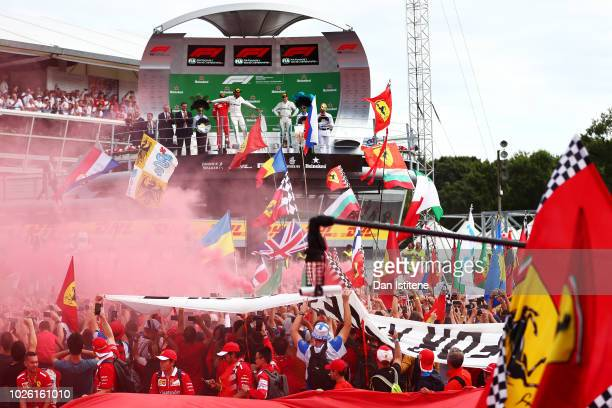 Lewis Hamilton of Great Britain and Mercedes GP celebrates his victory on the podium during the Formula One Grand Prix of Italy at Autodromo di Monza...