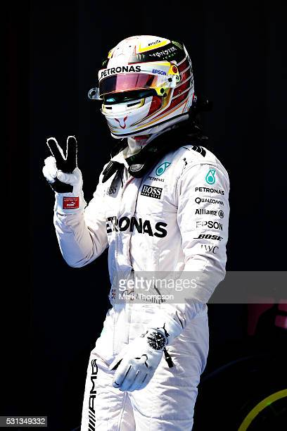 Lewis Hamilton of Great Britain and Mercedes GP celebrates his pole position in parc ferme during qualifying for the Spanish Formula One Grand Prix...