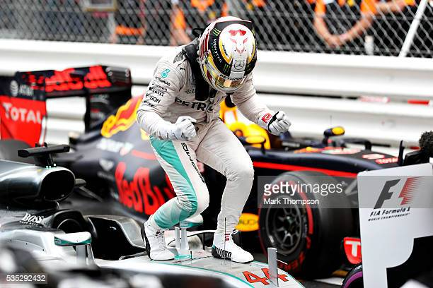 Lewis Hamilton of Great Britain and Mercedes GP celebrates his win in parc ferme during the Monaco Formula One Grand Prix at Circuit de Monaco on May...