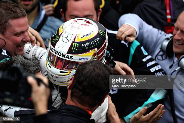 Lewis Hamilton of Great Britain and Mercedes GP celebrates his win in parc ferme during the Canadian Formula One Grand Prix at Circuit Gilles...