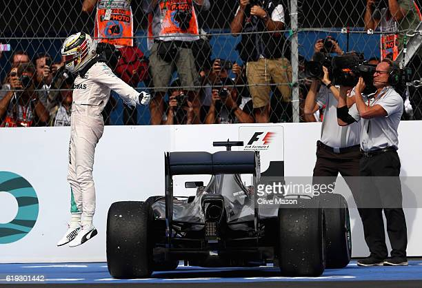 Lewis Hamilton of Great Britain and Mercedes GP celebrates his win in parc ferme during the Formula One Grand Prix of Mexico at Autodromo Hermanos...