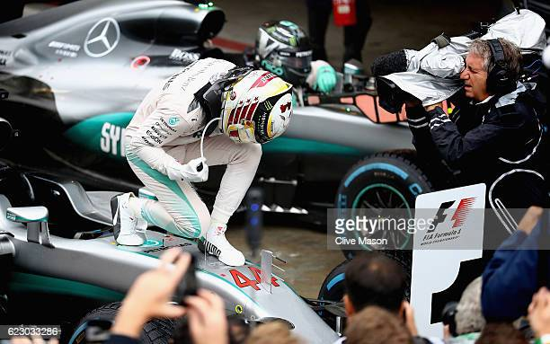 Lewis Hamilton of Great Britain and Mercedes GP celebrates his win in parc ferme during the Formula One Grand Prix of Brazil at Autodromo Jose Carlos...