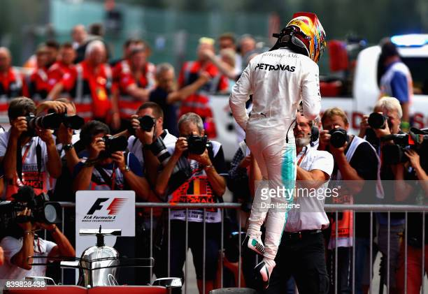 Lewis Hamilton of Great Britain and Mercedes GP celebrates his win in parc ferme during the Formula One Grand Prix of Belgium at Circuit de...