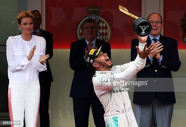 Lewis Hamilton of Great Britain and Mercedes GP celebrates his win on the podium during the Monaco Formula One Grand Prix at Circuit de Monaco on May...