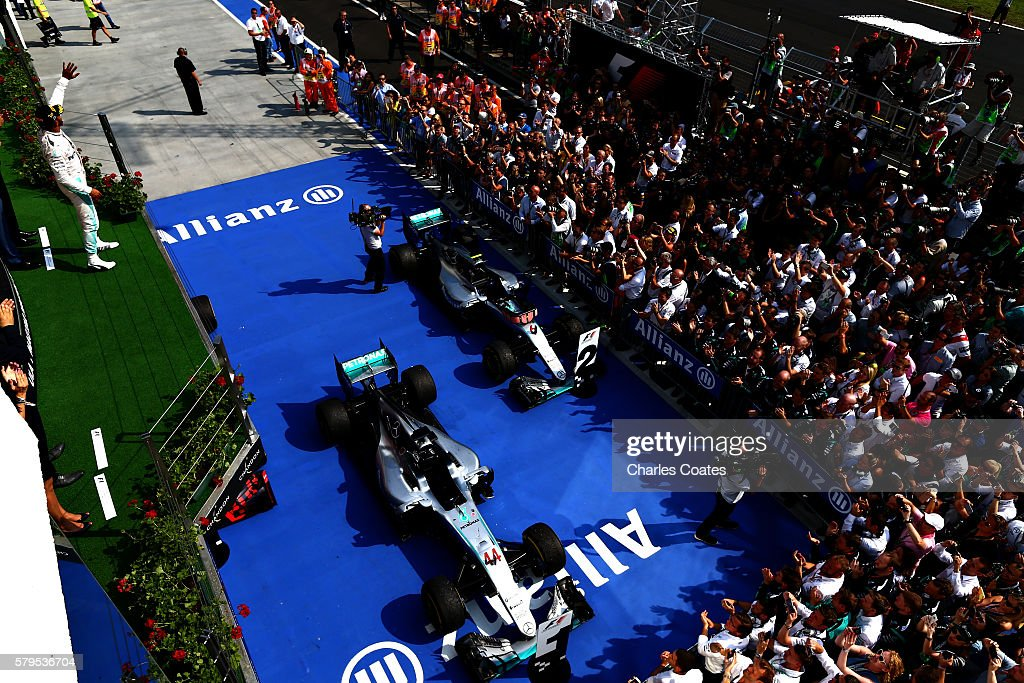 Lewis Hamilton of Great Britain and Mercedes GP celebrates his win on the podium during the Formula One Grand Prix of Hungary at Hungaroring on July 24, 2016 in Budapest, Hungary.