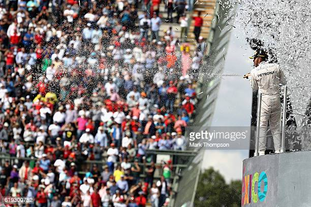 Lewis Hamilton of Great Britain and Mercedes GP celebrates his win on the podium during the Formula One Grand Prix of Mexico at Autodromo Hermanos...