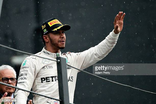 Lewis Hamilton of Great Britain and Mercedes GP celebrates his win on the podium during the Formula One Grand Prix of Brazil at Autodromo Jose Carlos...