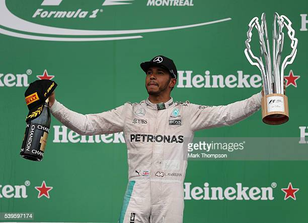 Lewis Hamilton of Great Britain and Mercedes GP celebrates his win during the Canadian Formula One Grand Prix at Circuit Gilles Villeneuve on June 12...