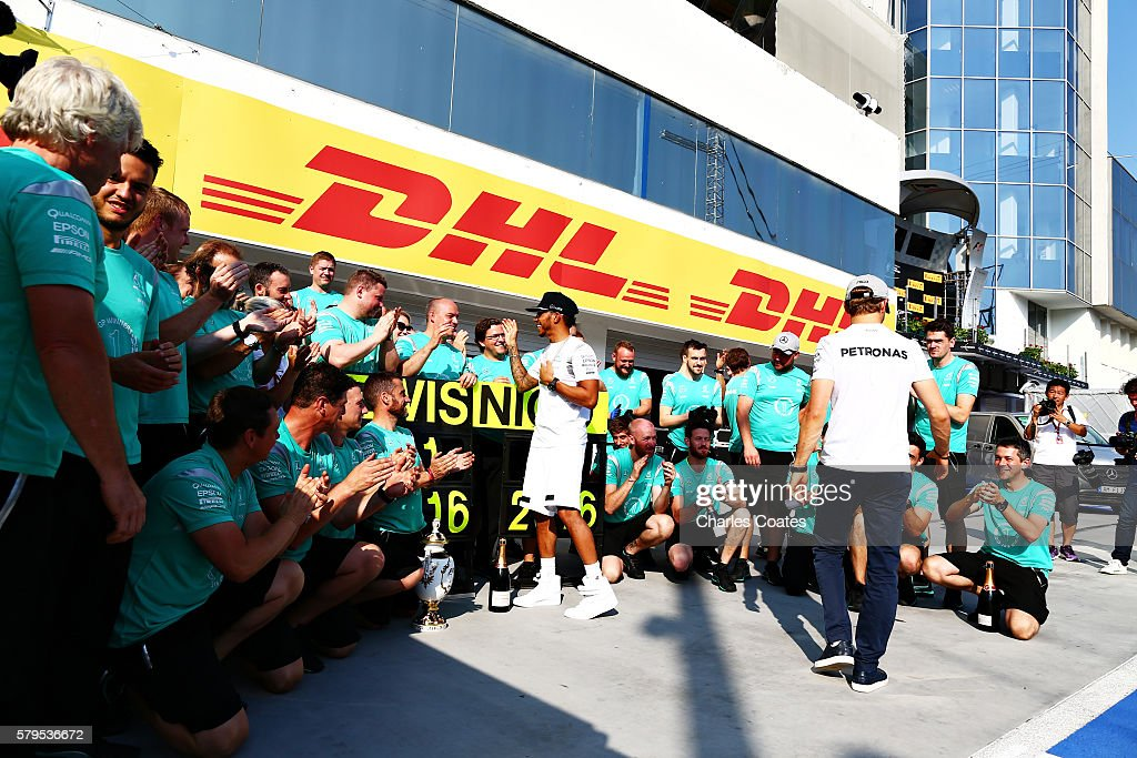 Lewis Hamilton of Great Britain and Mercedes GP celebrates his win with his team during the Formula One Grand Prix of Hungary at Hungaroring on July 24, 2016 in Budapest, Hungary.